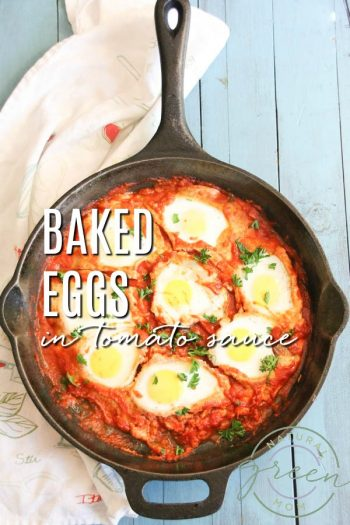 Cast Iron Skillet with baked eggs in tomato sauce on blue background