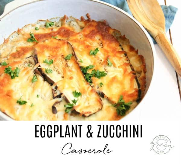 Eggplant and zucchini casserole layered in a round white baking dish.