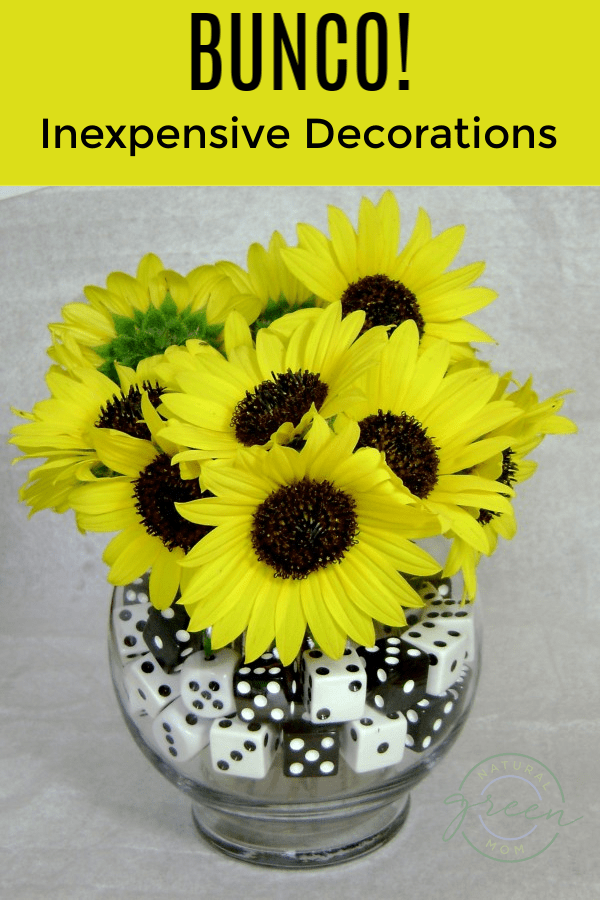 bunco inexpensive decorations like a flower arrangement surrounded by dice.