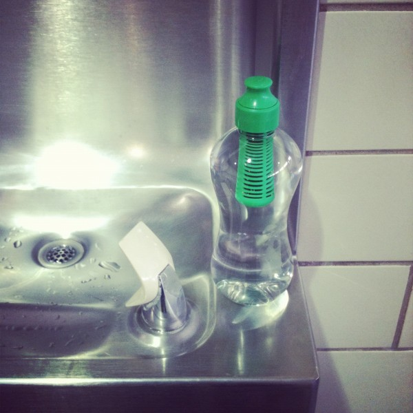 """Filling a bobble water bottle for a plane trip and lamenting, """"Why is it hard to drink water?"""""""