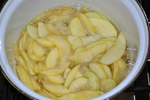 Apples cooking for homemade apple cider pie