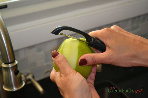 Peeling apples for homemade apple cider pie