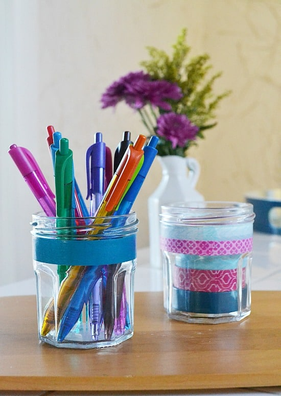 two jars. one holding washi tape, one holding pens.