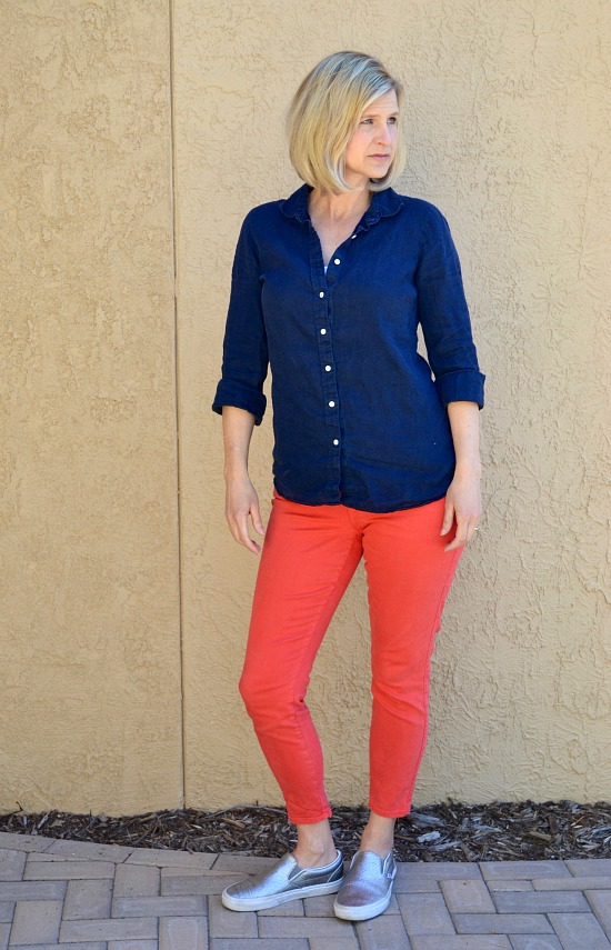 Coral skinny jeans with a navy button up top. Silver slip-on vans. Capsule wardrobe idea for a SAHM.