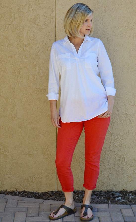 SAHM capsule wardrobe idea coral skinny jeans rolled up, oversized white linen tunic, birkenstocks.