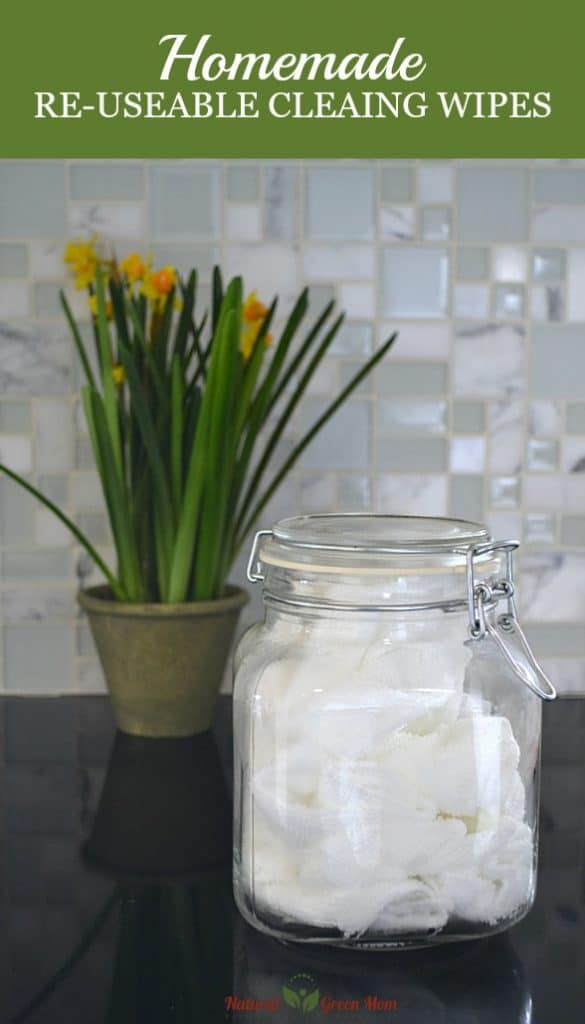 homemade re-useable cleaning wipes in a jar on the counter with flowers