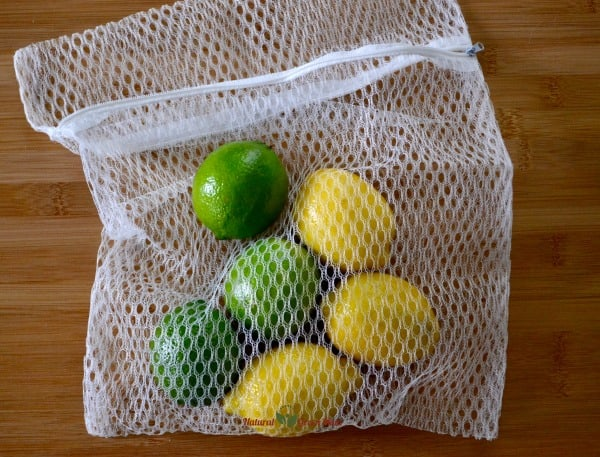 mesh laundry bag with lemons and limes