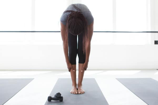 woman exercising bent over in a stretch