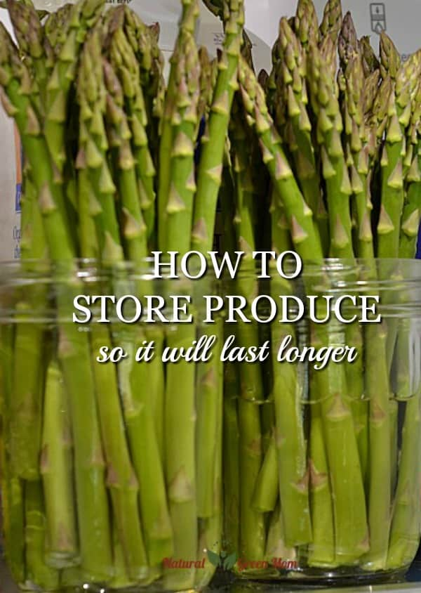 asparagus stalks in wide mouthed ball canning jars demonstrating How to Store Produce So It Will Last Longer