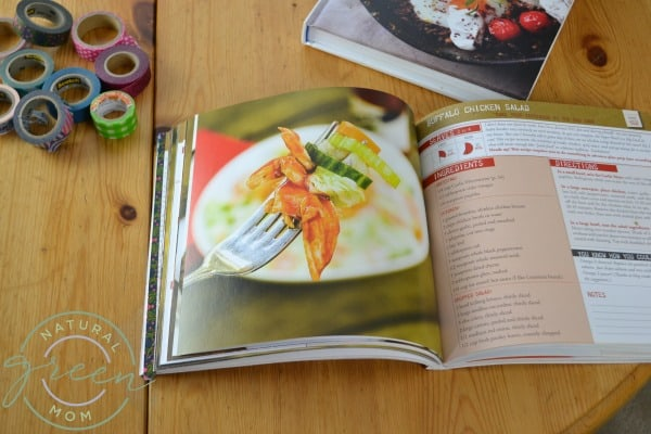 Cookbook on table turned to favorite recipe for recipe organizing