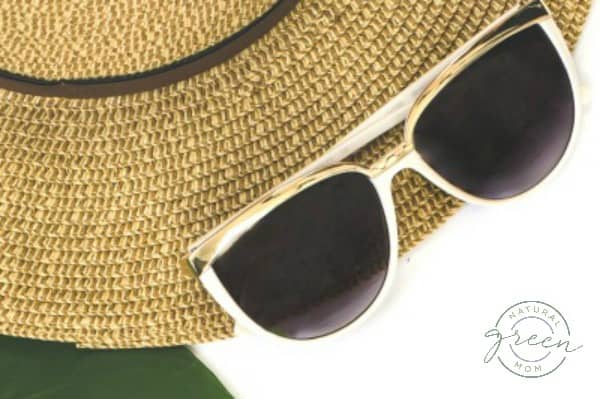 gold framed sunglasses and straw hat used to shield face from seasonal allergies