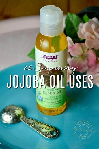 Pink tray with blue plate on top with bottle of jojoba oil displayed. Title reads 25 Surprising Jojoba Oil Uses