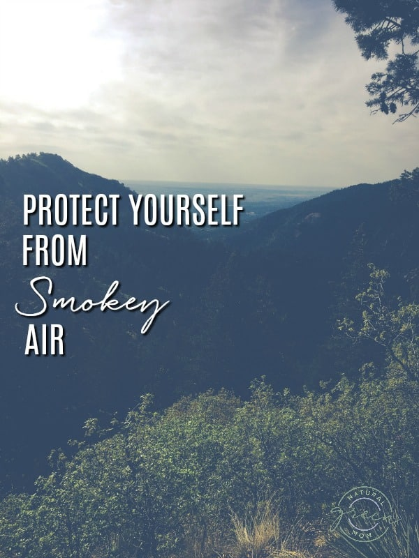 Smoke filled air above mountain with title protect yourself from smokey air