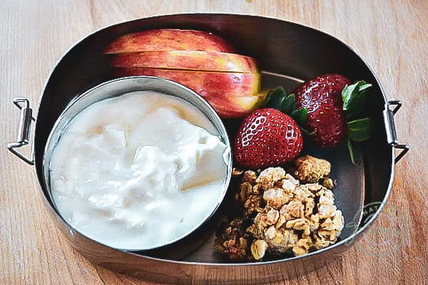snack box with oatmeal jam bars, apples, strawberries, and yogurt
