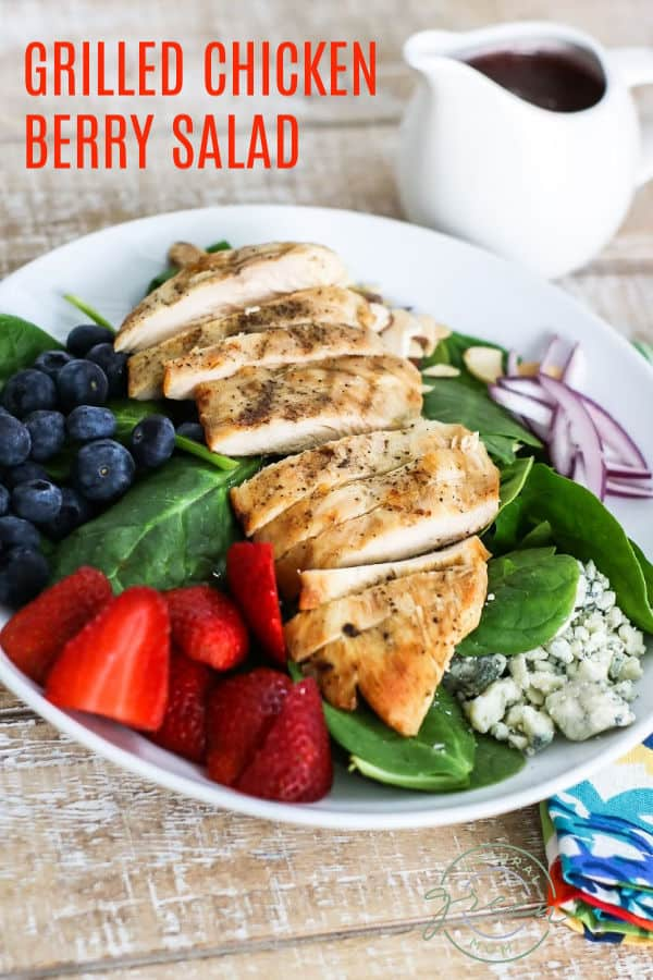 Grilled chicken on a bed of spinach with blueberries, strawberries, red onion, and blue cheese crumbles.