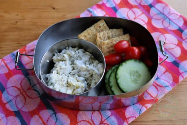 Easy cottage cheese lunch idea. Dill cottage cheese dip served with Triscuits and sliced cucumbers for dipping.