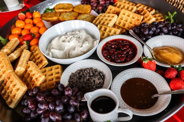 Friends, family, and guests will be delighted by these Belgian Waffle Bar ideas. Print out the shopping list then assemble your own massive platter.