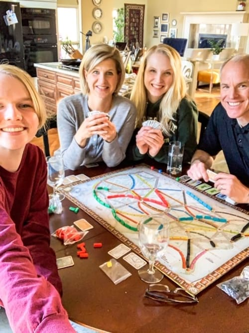 Natural Green Mom family playing most popular board games
