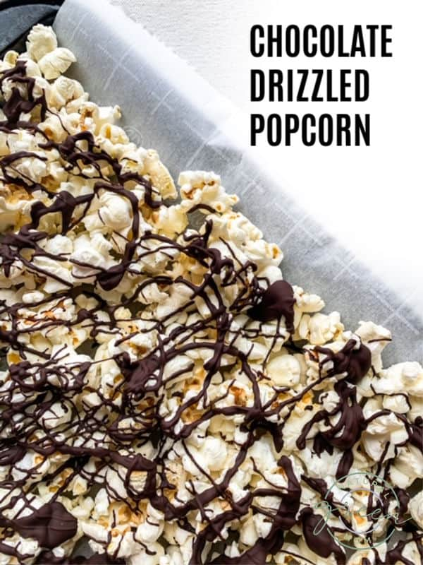 Tray of popcorn drizzled with dark chocolate.