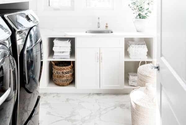 black washer and dryer with white laundry baskets