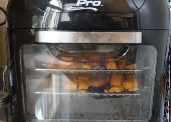 Butternut squash pieces inside an air fryer